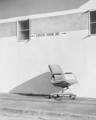 An office chair rolling down hill